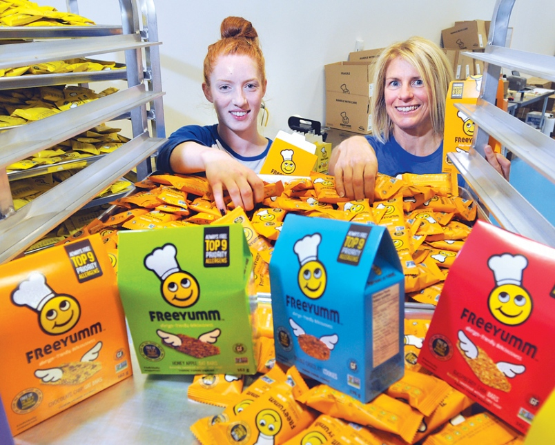 FreeYumm Foods head baker Kirsten Longva and owner Sarah Clarke package allergen-free snacks at the company's North Vancouver production facility.